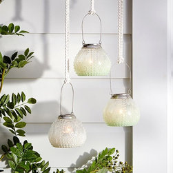 Milk Glass Hanging Votive Holder - There's something about milk glass that lends that old-fashioned touch to a room. These hanging votives are perfect for welcoming spring.