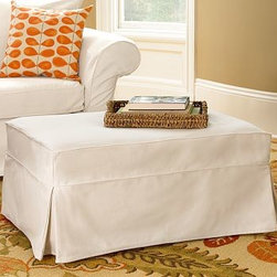 "Charleston Slipcovered Ottoman, Polyester Wrap Cushions, Washed Linen-Cotton Sil - Casual style and expert American craftsmanship make our Charleston Ottoman soft and inviting. 38"" w x 26"" d x 18"" h {{link path='pages/popups/PB-FG-Charelston-3.html' class='popup' width='720' height='800'}}View the dimension diagram for more information{{/link}}. {{link path='pages/popups/PB-FG-Charelston-4.html' class='popup' width='720' height='800'}}The fit & measuring guide should be read prior to placing your order{{/link}}. Ottoman has a polyester-wrapped cushion. Proudly made in America, {{link path='/stylehouse/videos/videos/pbq_v36_rel.html?cm_sp=Video_PIP-_-PBQUALITY-_-SUTTER_STREET' class='popup' width='950' height='300'}}view video{{/link}}. For shipping and return information, click on the shipping info tab. When making your selection, see the Special Order fabrics below. {{link path='pages/popups/PB-FG-Charelston-5.html' class='popup' width='720' height='800'}} Additional fabrics not shown below can be seen here{{/link}}. Please call 1.888.779.5176 to place your order for these additional fabrics."