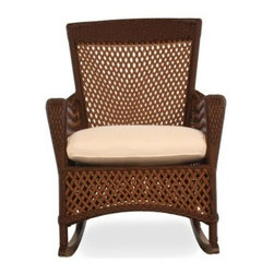 Lloyd Flanders Grand Traverse Porch Rocker - Spend your entire summer outdoors with the Lloyd Flanders Grand Traverse Porch Rocker. This tasteful patio rocker features a classic old rattan aesthetic crafted with a unique vinyl woven strand for a piece that offers the best of classic styling with the latest in durable, all-weather craftsmanship. Constructed from weather-resilient resin wicker, this rocker will not rot, fade or crack from exposure to harsh weather conditions. The plush, comfort-plus cushion provides a relaxing seat that dries quickly for year-round use.The high backrest and subtle dip of the armrests create a timeless style which is furthered by the hand-woven open lattice structure. Choose from a variety of frame finishes and cushion fabrics for the piece that best complements your home, patio, deck or garden.About Lloyd/FlandersCarrying on the traditions of Marshall B. Lloyd, Lloyd/Flanders brings the sophistication of timeless furniture designs to a sophisticated, modern audience. Using modern production processes and materials, these classic styles are faithfully rendered in a way that can be enjoyed by customers anywhere with high-quality construction and reliable, all-weather designs.