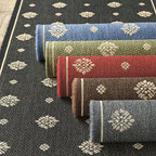 Ballard Designs - Navarre Indoor/Outdoor Rug - The airy medallion motif was inspired by a piece of antique fabric. Machine loomed in a soft sisal weave of 100% polypropylene construction. Resists fading and mildew. To clean this durable patio rug, just wash with mild soap and water and rinse with a hose. Imported from Belgium. Use of a Rug Pad is recommended.