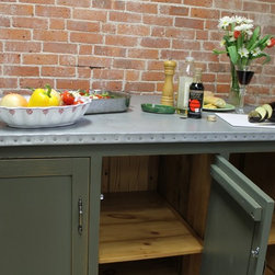 """Kitchen Island with Built-in Storage - When we thought about the perfect compliment to our farm table and barn wood collection, we all agreed that zinc was a natural progression.  Subtle, elegant and highly durable, zinc is one of the few metal eating surfaces that are food safe and is found in many foods we eat and can be found in every cell of our body.  While we don't suggest you nibble on our tables as a vitamin supplement, we highly recommend this surface for baking, eating , artwork and much much more.   Patinas naturally with age and only gets better with time.  The old wood base on this kitchen island is painted  in Sherwin Williams """"Pewter Green"""" has was glazed with a rub thru finish.   Design your own island and call for details.  Size seen:  60″ x 40″ x 36″h"""