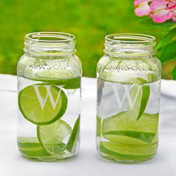 Home Decorators Collection - Monogram 26 oz. Mason Jar - Set of 2 - Large in size and timeless in appeal, our Monogram 26 oz. Mason Jars are great for both drinking and decorating. Use them to sip your favorite summertime beverage, or fill them with flowers, shells, rocks or candles to add a touch of country charm to any space. Set of 2. Clear glass. Each may be engraved with a single block letter at no additional cost.