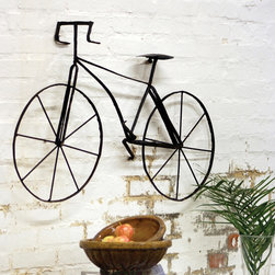 Metal Bicycle Wall Art - Add some urban flair to your outdoor space with this Metal Bicycle Wall Art.  Made with scrap metal, it radiates an industrial-cool vibe that contrasts well with potted plants and herb gardens.