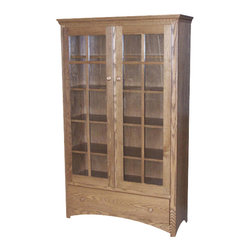 Chelsea Home Furniture - Chelsea Home Warren 68 Inch Bookcase in Red Oak - If your books hold a special place in your heart, the bookcase that holds them should be special, too. This handcrafted mission style red Oak bookcase in Smoked Sand finish is constructed with care to carry your beloved books from generation to generation. This bookcase has 2 glass cabinet doors and 3 inside adjustable shelves to put all your favorite titles proudly on display. Chelsea Home Furniture proudly offers handcrafted American made heirloom quality furniture, custom made for you. What makes heirloom quality furniture? It�s knowing how to turn a house into a home. It�s clean lines, ingenuity and impeccable construction derived from solid woods, not veneers or printed finishes over composites or wood products _ the best nature has to offer. It�s creating memories. It�s ensuring the furniture you buy today will still be the same 100 years from now! Every piece of furniture in our collection is built by expert furniture artisans with a standard of superiority that is unmatched by mass-produced composite materials imported from Asia or produced domestically. This rare standard is evident through our use of the finest materials available, such as locally grown hardwoods of many varieties, and pine, which make our products durable and long lasting. Many pieces are signed by the craftsman that produces them, as these artisans are proud of the work they do! These American made pieces are built with mastery, using mortise-and-tenon joints that have been used by woodworkers for thousands of years. In addition, our craftsmen use tongue-in-groove construction, and screws instead of nails during assembly and dovetailing _both painstaking techniques that are hard to come by in today�s marketplace. And with a wide array of stains available, you can create an original piece of furniture that not only matches your living space, but your personality. So adorn your home with a piece of furniture that wi