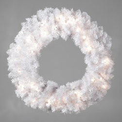 East West Basics (HK) Ltd - 24 in. Winter Park Pre-lit Wreath Multicolor - TI920-W300E-50LC - Shop for Holiday Ornaments and Decor from Hayneedle.com! Decorate your door or mantle with something truly unique this holiday with the 24 in. Winter Park Pre-lit Wreath. With 300 tips this wreath offers plenty of room to hang your favorite decorations and the striking white foliage creates a stunning backdrop for any color. It's pre-lit with 50 lights so it's ready to hang whenever you are. Cord Length on wreath is 28 inches long. Care instructions: While in use be sure to keep this product out of direct sunlight to avoid discoloration. When in storage keep this product covered as dust build-up may also cause an undesirable discoloration. Follow these directions for years of enjoyable use.