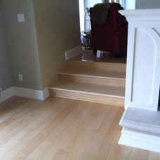 Contemporary Hardwood Flooring by WOOD ENVY INTERIORS