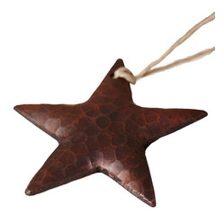 Native Trails - Medium Copper Star Ornament - Star power. This hand-hammered copper star arrives ready for gift giving in a pretty organza bag. Or, pull it out and tie it atop a gift for added impact.
