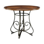 Powell Furniture - Hamilton Gathering Table in Matte Pewter & Br - Curve and scroll designed bottom. Add interest and ample table space to any home decor. Top of the back piece is a sleek brushed faux Medium Cherry wood. 42 in. Dia. x 36 in. H