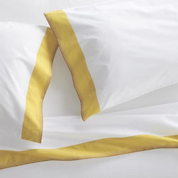"""Miri Yellow Queen Sheet Set - Pigment-dyed yellow trim bands crisp, white bedding in rich color, playfully accented with five rows of contrast stitching. Versatile look in soft, cotton percale mixes and matches for a varied, layered bed. Generous 16 """" pockets (14"""" for twin) accommodate most mattresses. Bed pillows also available."""
