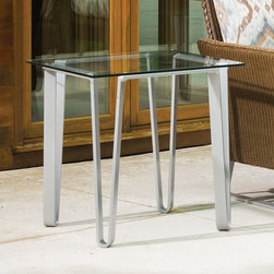 Lloyd Flanders - Lloyd Flanders Nova Square End Table Multicolor - 111043 - Shop for Tables from Hayneedle.com! Bring contemporary comfort to your favorite outdoor space with the Lloyd Flanders Nova Square End Table. This sleek table is designed by Mathias Hoffman with modern style in mind. It features a square reflective surface crafted from a sheet of solid glass that's supported by contoured metal legs. It offers just the right amount of space for setting aside some patio decoration or serving a few drinks and appetizers. Its uniquely fashioned legs complement the sled base seen on the ottomans and chairs from the Nova collection and boasts an exclusive metallic silver color that's E-coated for added durability. About Lloyd/FlandersCarrying on the traditions of Marshall B. Lloyd Lloyd/Flanders brings the sophistication of timeless furniture designs to a sophisticated modern audience. Using modern production processes and materials these classic styles are faithfully rendered in a way that can be enjoyed by customers anywhere with high-quality construction and reliable all-weather designs.