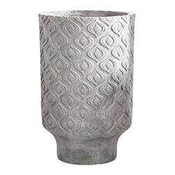 "Reno Planter, 22"" X 14.25"" - Sculpted, almond-shaped motifs- a pointed arabesque take on the ""eye"" designs that have become so integral to creating an international flair in your decor- form a deconstructed lattice to cover the walls of the Large Reno Planter, a cylinder of sandstone texture resting on a tapered base for elegance and height. This dimensional, patterned piece is easily integrated with your chosen neutral color."