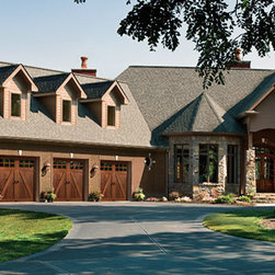 Clopay Canyon Ridge Collection - The rustic orange color of this home coordinates perfectly with wooden garage doors.