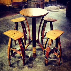 "Pub Tables - Vinoture Flora table. This pub table is made from reclaimed French oak wine barrels and stands at 42"" height with a table top diameter of 22"" -25""."
