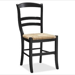 "Isabella Side Chair, Black - Offering a bright, colorful update to ladderback seating, our Isabella Chairs refresh your dining space in an instant. Create an eclectic look by mixing and matching chairs in a variety of hues. 16.5"" wide x 20"" deep x 35.25"" high Expertly crafted of solid hardwood. Rush seats are woven of natural rye. Detailed with a hand-rubbed finish with light distressing around the edges. See available finishes below. Wood swatches, below, are available for $25 each. We will provide a merchandise refund for wood swatches if they're returned within 30 days. Side chair is sized for use with our small PB Classic Dining Cushion. Select items are Catalog / Internet Only. View our {{link path='pages/popups/fb-dining.html' class='popup' width='480' height='300'}}Furniture Brochure{{/link}}."