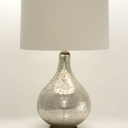 Winter Solstice Lamp - Flecked with age and frosted with authentic softness, the mercury glass of the Winter Solstice Lamp forms a bulb shape that's classic and assured.  The final addition to an impressive collection of mercury glass or the start of a new taste for vintage metallic tones, this silver table lamp includes a plain neutral drum shade that secures to the body with a matching spherical knob.