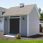 "10' x 12' Quivett Cottage Low Maintenance - Features 6' double 2 paneled beaded door with 6' PVC transom window for exttra light. Credar singles factory treated with bleaching oil for good looks and long life. Raised wall heigh, two handsome light blocks, architectural roof shingles, and topped off with a low maintenance 16"" cellular PVC cupola."