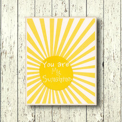 'You are My Sunshine' Wall Art by Lil Chipie - There are so many things you could do with this phrase, but I like this graphic sun art for over the changing table.