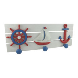 Red, White and Blue Nautical Wooden Wall Pegs - This wooden wall plaque complements your beach or nautical decor, and has 3 pegs for dog leashes, reusable grocery bags, light jackets, or anything you may want to keep handy. It measures 21 3/4 inches long, 8 inches tall, 2 1/2 inches deep and features blue pegs under a ship's wheel, sailboat, and anchor. This plaque is hand painted in red, white, and blue and easily mounts to the wall by two picture hangers on the back.