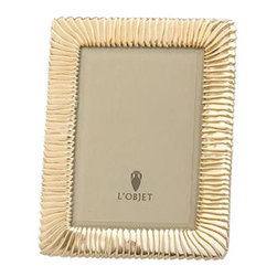 "L'Objet - L'Objet Matte Gold Pleated Frame 5x7 - L'Objet is best known for using ancient design techniques to create timeless, yetdecidedly modern serveware, dishes, home decor and gifts. 14k Gold Plated Photo Frame"" Beveled Glass"" Wrapped in Genuine Leather Choose 4x6, 5x7, 8x10 Size"" Luxuriously Gift Boxed. Each frame is meticulously handcrafted and detailed with beveled glass, satin liner, leather back, and decorative closures."