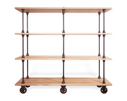 Kathy Kuo Home - Allenby Industrial Weathered Oak 4 Shelf Rolling Bookcase - L - Weathered and worn and crafted by the best, this reclaimed wood industrial bookshelf is set to steal the show in your living room. Picture perfect from every angle, whether you're capturing the crisp, clean oak wood shelves or the crisp cast iron rods that hold them together, this piece is about as stunning as it gets. Statuesque and commanding, this a piece that deserves to shine with carefully styled vignettes, whether they be vintage decanters or family photos. Enjoy a one year warranty on this piece.