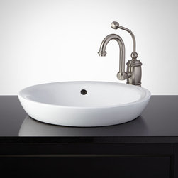 Milforde Semi-Recessed Sink - Resting partly inside the counter and partly above-counter, this semi-recessed porcelain sink gives your bathroom a stylish, modern look. Its porcelain surface is nonporous for easy cleaning.Pair with your favorite single-hole faucet to complete the look.