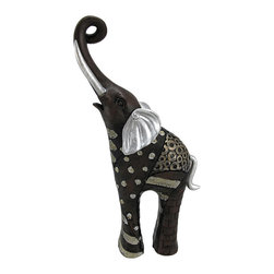 Hand Painted Abstract Elephant Statue Figure - This stunning hand-painted abstract statue is of a patchwork elephant, trunk raised high. The statue measures 10 1/4 inches high, 5 1/4 inches across and 2 1/2 inches deep. Made of cold cast resin, it`s finished in black, silver, gold and metallic brown enamels. It makes a great gift for friends and family.