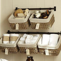 "Hannah Wall Basket Storage System Small Towel Bar - Our Hannah system provides compact, versatile storage that frees up floor space. Combine its components to maximize organization. Because it's modular, it can be configured to suit various spaces and needs. Small Bar: 27"" long x 2"" deep x 3"" high Large Bar: 37"" long x 2"" deep x 3"" high Basket: 12.75"" wide x 10"" deep x 7.75"" high Bar made of iron with a matte rustic finish. Bar is rust resistant. Bar can double as a towel rack. Each bar holds ups to two baskets. Bar hook slips into the weave of the basket. Wicker basket includes removable polyester liner. View our {{link path='pages/popups/fb-bath.html' class='popup' width='480' height='300'}}Furniture Brochure{{/link}}. Internet only."