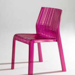 Kartell Frilly Chair, Set of Two - Yes, it's frilly, but it's not silly! This funky chair has wavy lines and comes in a slew of fun colors. You can use it indoors or outdoors, and it's sold in sets of two.