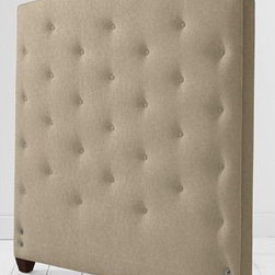 Tufted Slipcovered Headboard - This lovely tufted headboard is available in a plethora of fabrics and colors. It's a time-tested design that never seems to go out of style, giving you a soft place to prop your pillows.