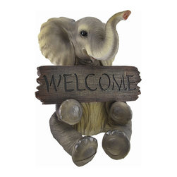 Adorable `Pachy Princess` Baby Elephant `Welcome` Sign Home Decor - This adorable little elephant welcomes all with open arms and big floppy ears. The precious pachyderm holds a `Welcome` sign with the look of a real wooden board and raises her trunk in salutation. Made from cold cast resin, the statue measures 15 inches tall, 14 inches deep, and 13 inches wide. The figure exhibits remarkable detail in its hand crafted and hand painted design. This little amiable fellow is a wonderfully cute home accent with a durable resin construction that looks great indoors and won`t wear down on an outdoor front porch. It`s a splendid gift for elephant lovers.