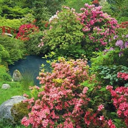 Tranquil Time Puzzle - 1500 Piece Jigsaw PuzzleThis garden grows in boundless color.  Mounds of flowering bushes help shape this tranquil view.  In the background is the gentle curve     of a crimson footbridge, nearly overlooked by the bursts of surrounding color and pillows of green.
