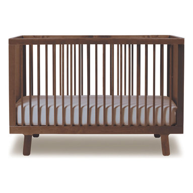 Oeuf Sparrow Crib, Walnut - Arguably, I say the crib is the starting point for a nursery. Everything else can be built around this one piece. This Oeuf crib is classic and modern with its great legs and spindles. I love it in walnut.