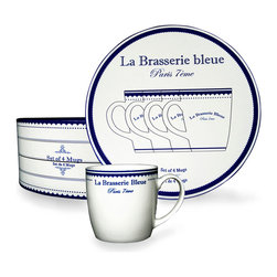 "Brasserie Bleue Mugs - Set of 4 - The classic coffee-mug silhouette is as appropriate on the table after a dinner party as it is for a family breakfast gathered around the kitchen island. This take on the traditional dining necessity is painted with the inscription ""Brasserie Bleue"" in a rich royal shade on white, then rimmed in colored scallops to complete the charming detail of this two-tone mug."