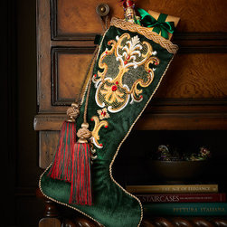 """Jay Strongwater - Palazza Christmas Stocking - Jay StrongwaterPalazza Christmas StockingDetailsMade of cotton/polyester velvet with silk embroidery.Hand embroidered and hand embellished with Swarovski crystals and beads.12.25""""W x 23.25""""L.Imported.Designer About Jay Strongwater:Jay Strongwater's love of the elegant but vividly bejeweled objet whether it's meant to rest on a tabletop or the graceful curve of a woman's neck has led him on a journey through the worlds of fashion and home furnishings. He began his career while a student at the Rhode Island School of Design. After garnering raves for a necklace he'd made his mother he took jewelry samples to open buyer days at some of New York's finest department stores and soon a burgeoning business was born. At the age of 23 Strongwater met designer Oscar de la Renta with whom he began to collaborate on jewelry designs for runway shows. The move to home accessories was delightfully serendipitous & organic. For the 1994 holiday season Strongwater sent gifts of jewel-encrusted filigree picture frames to friends fashion editors and buyers who immediately fell in love with the design. By 1998 his Jewels for the Home collection had supplanted his fashion business. In essence Strongwater created his own niche: the jeweler turning his meticulous eye and art toward a world beyond a woman's wrists neck and ears."""