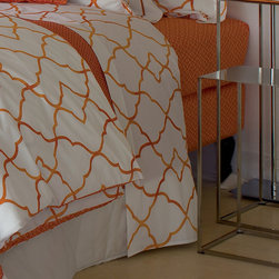 "Frontgate - Yves Delorme Jali Safran Flat Sheet - Made of Egyptian combed cotton. White background complements the crisp coral Safran graphic. Flat sheets feature gate-like graphic on both sides. Machine wash at a maximum of 140 degrees Fahrenheit, regular spin cycle; do not use bleach. Do not tumble dry at a temperature exceeding 113 degrees. With a modern design echoing the lattice-like stone dividers (""jali"") used in Hindu and Arabic architecture, our Yves Delorme Jali Flat Sheet imbues your inner sanctum with a fresh yet private feel. The abstract, geometric coral graphic is printed on cool white percale.  .  .  .  .  . Do not iron at a temperature exceeding 302 degrees . Made in France."