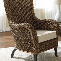 "Hospitality Rattan Cozmel Full Frame Wicker Lounge Chair with Cushions - Antique - The Hospitality Rattan Cozmel Full Frame Wicker Lounge Chair with Cushions - Antique is about the best thing to come from a banana since the cream pie. This tall chair and its curved arms and wraparound back are crafted from woven banana leaves around a rugged wooden frame. Commercial quality rattan poles create the feet that help keep this chair up, and a deep seat cushion adds the comfort that will keep you from getting up. If you're the kind of person who buys your bananas in bunches, try adding the Hospitality Rattan Cozmel Full Frame Wicker End Table with Glass as a companion piece to this appealing chair.About Hospitality RattanHospitality Rattan has been a leading manufacturer and distributor of contract quality rattan, wicker, and bamboo furnishings since 2000. The company's product lines have become dominant in the Casual Rattan, Wicker, and Outdoor Markets because of their quality construction, variety, and attractive design. Designed for buyers who appreciate upscale furniture with a tropical feel, Hospitality Rattan offers a range of indoor and outdoor collections featuring all-aluminum frames woven with Viro or Rehau synthetic wicker fiber that will not fade or crack when subjected to the elements. Hospitality Rattan furniture is manufactured to hospitality specifications and quality standards, which exceed the standards for residential use.Hospitality Rattan's Environmental CommitmentHospitality Rattan is continually looking for ways to limit their impact on the environment and is always trying to use the most environmentally friendly manufacturing techniques and materials possible. The company manufactures the highest quality furniture following sound and responsible environmental policies, with minimal impact on natural resources. Hospitality Rattan is also committed to achieving environmental best practices throughout its activity whenever this is practical and takes responsibility for the development and implementation of environmental best practices throughout all operations. Hospitality Rattan maintains a policy of continuous environmental improvement and therefore is a continuing work in progress.Hospitality Rattan's Environmentally Friendly Manufacturing ProcessAll of Hospitality Rattan products are green. From its basic raw materials of rattan poles, peels, leather, bamboo, abaca, lampacanay, wood, leather strips, and boards, down to other materials like nails, staples, water-based adhesives, finishes, stains, glazes and packing materials, all have minimum impact to the environment and are safe, biodegradable, recycled, and mostly recyclable. Aside from this, the products have undergone an environmentally-friendly process that makes them ""greener."" The company's rattan components are sourced from sustained-yield managed forests, which means the methods used to grow and harvest the rattan vines ensure the long-term life of the forest and protect the biodiversity of the forest's ecosystems.Hospitality Rattan is committed to buying and using all materials, from rattan and hardwood to finishing materials, from reputable and renewable suppliers and seeks appropriate evidence that suppliers are in compliance with this policy. Hospitality Rattan strives to use materials that are processed in an environmentally responsible manner, or consist of a high level of recycled material. Finishing materials and stains used in Hospitality Rattan's furniture products consist of 75% water-based solutions which evaporate upon application with reduced or Volatile Organic Compounds (VOCs). The furniture factories use water-based glues, stains, topcoats and other finishes on all of their products. The switch from traditional solvent-based processes to water-based processes involved consolidating several processes by the factories, resulting in an 85% reduction in VOC emissions."