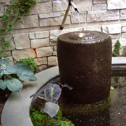 Antique Belong Water Feature - Passed through the generations, these stone vessels were used in Indonesia to hold water and food for families. The age of each piece ranges from 75 to 200 years and possibly more. The antique belong is a natural addition to any garden and is internationally a sought after collectors piece. Each reclaimed piece is unique in its character with differing shape, size and type of stone
