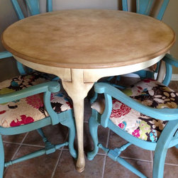 Available - Fun colors and a time worn custom paint technique make this a one of a kind breakfast table and four chairs. Annie Sloan Chalk Paint Provence and Country Grey with a custom mixed glaze to coordinate with the beautiful fabric.