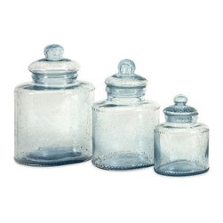 IMAX Cyprus Glass Canisters - Set of 3 - Fill the IMAX Cyprus Glass Canisters - Set of 3 with whatever you want. It can be coffee, sugar - anything will look lovely in these classic-style canisters. Each canister is made from seeded glass that's food-safe and tightly sealed with a glass lid.Canister dimensions:4.5L x 4.5W x 6.75H in5.5L x 5.5W x 10.25H in6.5L 6.5W x 11.25H inAbout IMAXWhat began as a small company importing copper flower containers in 1984 by Al and Faye Bulak has developed into one of the top U.S. import companies serving the At Home market today. IMAX now provides home and garden accessories imported from twelve countries around the world, housed in a 500,000 square foot distribution center. Additional sourcing, product development and showroom facilities in the USA, India and China make IMAX a true global source. They're dedicated to providing products designed to meet your needs. This is achieved through a design and product development team that pushes creativity, taste and fashion trends - layering styles, periods, textures, and regions of the world - to create a visually delightful and meaningful environment. At IMAX, they believe style, integrity, and great design can make living easier.