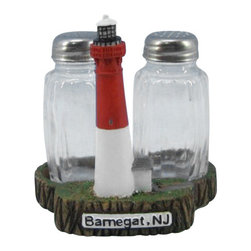 """Handcrafted Model Ships - Barnegat Lighthouse Salt and Pepper Shakers 4"""" - Nautical Lighthouse - This Barnegat Lighthouse Salt and Pepper Shakers 4"""" is one of the cutest salt and pepper sets available anywhere! This Barnegat Lighthouse Salt and Pepper Shakers 4"""" is a definite must for the lighthouse or nautical enthusiast. This lighthouse decoration will surely brighten up your kitchen table, shelves or countertop. Cooks and collectors will delight in owning this fun loving set. See our vast selection of other famous lighthouses from all over the world."""
