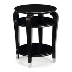 Magnussen Furniture - Harper Round Accent Table - Traditional style. Classic design. Two shelves. Curved legs arch upward as if on tip-toe to balance the oval-inlaid top. Metal cap on leg bottoms. Wipe with a damp cloth and use a mild soap. Warranty: One year limited. Made from cherry veneers with hardwood solids. Stunning ebonized black cherry finish. 20 in. Dia. x 26 in. H (36 lbs.)Modernized to mix with more-transitional schemes, Harpers classic lines and subtle details remain firmly rooted in traditional decor. Be careful when using commercial cleaners and follow all manufacturer instructions, test them on a small inconspicuous area first. Do not use chemical cleaners or glass cleaners on finish as they may break down the finish.