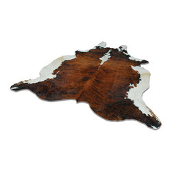 Cowhide Rug, Honey Yerra - This Argentinian cowhide adds a rustic touch to any room. It works with any style from very modern to cowboy chic.