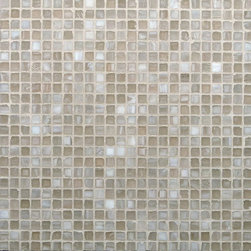 "Glass Tile Oasis - Light Wood 1/2"" x 1/2"" Cream/Beige Pool Frosted Glass - Sheet size:  12 5/8"" x 12 5/8""     Tile Size:  1/2"" x 1/2""     Tiles per sheet:  576     Tile thickness:  1/4""     Recycled Components:   20%     Sheet Mount:  Paper Face      Sold by the sheet    -  Brilliant glass combed through with coordinating colors and available in 14 mouth-watering colors  in both Iridescent and Frost finishes.Waterfall tiles are hand-poured and will have a certain amount of variation and variegation of color  tone  shade and size. Additionally  you will notice creases  wrinkles  shivers  waves  bubbles topped off with a natural surface to catch all forms of light for a brilliant effect. These characteristics of natural glass and only serve to enhance the final beauty of the installation."