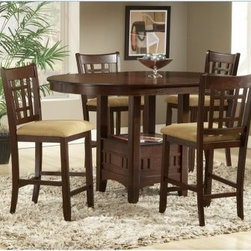 Randolph 5 Piece Cherry Round Counter Height Dining Table Set - Sweet with a bit of a tart finish the Randolph 5 pc. Cherry Round Counter Height Dining Table Set will kick your dining room in the pants. The Mission-style set features a striking detailed base and chairs that are all about geometry. The round to oval tabletop is a stunning contrast and the rich cherry finish will warm up your entire room. Sit back and enjoy your style choices you've earned it. Made with selected hardwoods and veeneers with a rich cherry finish. The pedestal legs join to form a handy display shelf ideal for placemats magzines newspaper or quick access dinner items. Set includes counter height table and 4 counter charis. Table dimensions: 42-60L x 42W x 36.25H inches. Chair dimensions: 18W x 20D x 41.25H inches. About BernardsBernards is an importer and distributor of residential home furnishings. They offer products for all rooms at affordable prices and styles from traditional to contemporary. In order to bring the best values to their customers Bernards shops the world for specialties to meet the needs and desires of their retailers and customers. Located in Archdale NC. Bernards was founded in 1983 by Herman Bernard a pioneer in furniture importing. He set the standard for integrity that has been the foundation of the company ever since. You can count on Bernards to give you the facts and stand behind the products they sell.