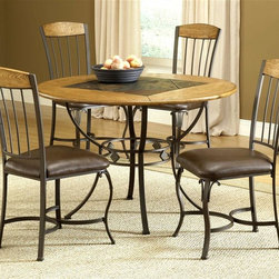 Hillsdale Furniture - Lakeview 5 Pc Round Dining Set w Wood Chairs - Set includes 1 Round Table, 4 Chairs. Composed of heavy gauge tubular steel, solid wood edges, climate controlled wood composites and veneers. Brown color. This unique group is a perfect addition to your home. Dining Chair w Wood Panel in Top: 18.125 in. W x 20.375 in. D x 38 in. H. Table: 45 Dia. x 30 in. H Rustic textures and colors combine to create Hillsdale Furniture's Lakeview dining collection. Boasting a striking fusion of�� medium oak wood, coppery brown metal, and a dynamic slate inlay in the center of the table, this group also features many options to customize your own ensemble, from a wood top chair or baker rack to a slate topped chair or baker rack with a diamond motif and a rectangle rounded edge or round table. Boasting easy to maintain and versatile brown faux leather seats, a pretty scrolled chair, and a rounded table bases with corresponding slate accents.