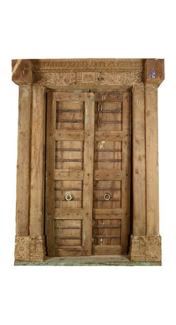 Sierra Living Concepts - Beautifully Preserved Hand Carved Historic Indian Door - This very impressive carved Indian antique style door is nothing short of delightful. The majestic carved piece at the top is a marvelous exemplification of Indian architectural art. The carvings on the frame indicate the original owner was in the spice trade.