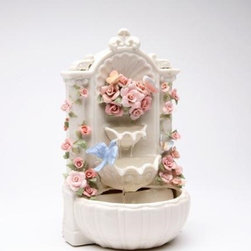 CG - 8.875 Inch Ceramic White Floral Fountain Music Box Decorated Figurine - This gorgeous 8.875 Inch Ceramic White Floral Fountain Music Box Decorated Figurine has the finest details and highest quality you will find anywhere! 8.875 Inch Ceramic White Floral Fountain Music Box Decorated Figurine is truly remarkable.