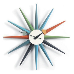 George Nelson - Classic Wooden Sunburst Clock - Uses 1 AA battery (not included). George Nelson classic design. Attractive sculptural shape. Perfect for any interior space including the home or the office. Made of wood and metal. 2.5 in. D x 18.5 in. W x 18.5 in. H (1.54 lbs.)The Nelson Classic Wooden Sunburst Clock was designed by George Nelson in the 1950's. The Sunburst Clock is one of the most recognized clocks in modern day history and provides a bright alternative to the less-than-exciting standard time pieces. The Sunburst Clock is widely considered to be one of George Nelson's most beloved design creations. This clock is one of the signature pieces in George Nelson Vitra clock collection. This mid century modern wall clock is an icon of modern design. This clock is battery powered with 1 AA battery and has a quartz driven mechanism. The highly decorative George Nelson clock collection is perfect for any interior space including the home or the office. These modern wall clocks have an attractive sculptural shape and they are a refreshing alternative to the usual traditional timekeepers.
