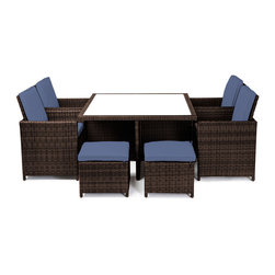 "Reef Rattan - Reef Rattan Carrera 9 Pc Cube Dining Set - Chocolate Rattan / Ocean Blue Cushion - Reef Rattan Carrera 9 Pc Cube Dining Set - Chocolate Rattan / Ocean Blue Cushions. This patio set is made from all-weather resin wicker and produced to fulfill your needs for high quality. The resin wicker in this patio set won't fade, shrink, lose its strength, or snap. UV resistant and water resistant, this patio set is durable and easy to maintain. A rust-free powder-coated aluminum frame provides strength to withstand years of use. Sunbrella fabrics on patio furniture lends you the sophistication of a five star hotel, right in your outdoor living space, featuring industry leading Sunbrella fabrics. Designed to reflect that ultra-chic look, and with superior resistance to the elements in a variety of climates, the series stands for comfort, class, and constancy. Recreating the poolside high end feel of an upmarket hotel for outdoor living in a residence or commercial space is easy with this patio furniture. After all, you want a set of patio furniture that's going to look great, and do so for the long-term. The canvas-like fabrics which are designed by Sunbrella utilize the latest synthetic fiber technology are engineered to resist stains and UV fading. This is patio furniture that is made to endure, along with the classic look they represent. When you're creating a comfortable and stylish outdoor room, you're looking for the best quality at a price that makes sense. Resin wicker looks like natural wicker but is made of synthetic polyethylene fiber. Resin wicker is durable & easy to maintain and resistant against the elements. UV Resistant Wicker. Welded aluminum frame is nearly in-destructible and rust free. Stain resistant sunbrella cushions are double-stitched for strength and are fully machine washable. Removable covers made with commercial grade zippers. Tables include tempered glass top. 5 year warranty on this product. Table: W 49"" x D 49"" x H 30"", Chairs (4): W 24.5"" x D 23"" x H 38"", Foot Stools with Cushions (4): W 20"" x D 20"" x H 15"""