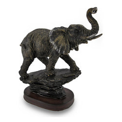 Antique Bronzed Walking Elephant Trunk-Up Statue - With its trunk raised to symbolize good luck, this elephant sculpture lends a touch of exotic African decor to your home or office. At 9 3/4 inches high (25 cm), 9 inches long (23 cm), and 4 inches wide (10 cm), this walking pachyderm statue is an amazingly detailed accent with painstakingly sculpted elephant hide, large floppy ears and a wrinkled trunk lifted in a traditional gesture of good luck. Made of cold cast resin, it has a wonderful antique bronze finish and foam pieces on the bottom to help protect delicate surfaces from scratches. This statue would make an excellent housewarming gift and a great gift for anyone keen on wildlife.